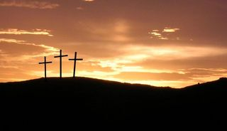 Sunset over three crosses